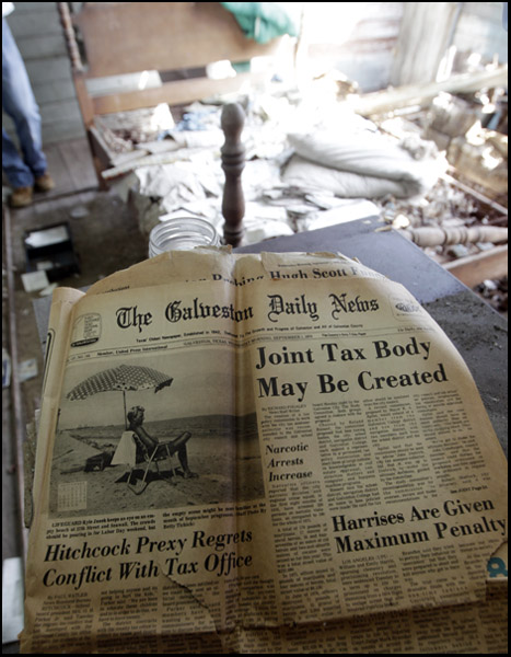 A copy of the Daily News from September 1, 1976 is seen inside of the home at 1406 Ave. L in Galveston is seen on Tuesday afternoon March 6, 2012. The home is one of two purchased by the Galveston Redevelopment and Community Enterprise Corp. to be restored with help from the Galveston Historical Foundation.