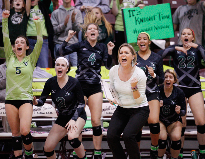 Clear Falls coach Lyndsay Hodges and her team celebrate a point during the third set of a regional quarterfinal playoff match against Pearland on Tuesday night November 12, 2013 at the Aldine ISD M.O. Campbell Center in Houston. The Knights swept the Oilers in straight sets (25-18, 25-17, 25-21) to advance to the regional semifinals on Friday.