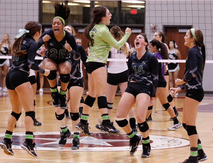 Clear Falls' Madelyn St. Germain, Madisson Gibson, Katie Ulrich, Morgan St. Germain, Alyssa Enneking and Skyler Tankersley celebrate after a regional quarterfinal playoff match against Pearland on Tuesday night November 12, 2013 at the Aldine ISD M.O. Campbell Center in Houston.